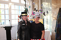 NWA Democrat-Gazette/CARIN SCHOPPMEYER Kelly McDonough, Eureka Springs School of the Arts executive director (left) and Suzanne Reed, board chairwoman, welcome guests to the annual Mad Hatter Ball benefit for the school on Oct. 18.