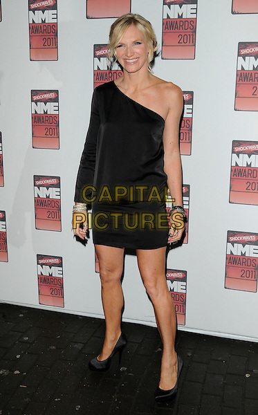 JO WHILEY.The Shockwaves NME Awards 2011 held at the O2 Academy Brixton - Arrivals London, England, UK,.23rd February 2011..full length black one shoulder sleeve dress shoes .CAP/CAN.©Can Nguyen/Capital Pictures.