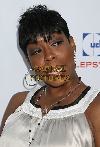 TICHINA ARNOLD.7th Annual Comedy For A Cure benefiting The Tuberous Sclerosis Alliance held at the Avalon, Hollywood, California, USA..April 6th, 2008.headshot portrait silver hoop earrings necklace funny face .CAP/ADM/RE.©Russ Elliot/AdMedia/Capital Pictures.