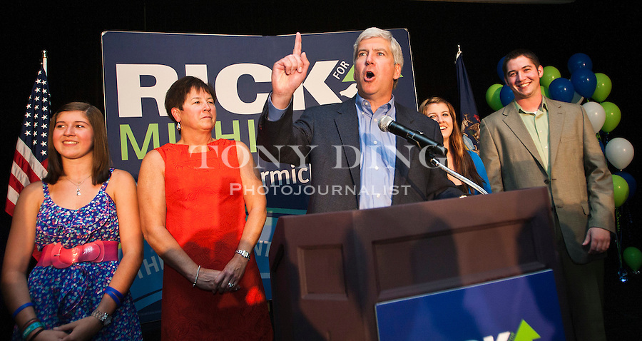Flanked by his family, Michigan Republican gubernatorial candidate Rick Snyder, center, delivers his victory speech to supporters after the day's primary election, Tuesday, Aug. 3, 2010, in Ypsilanti, Mich. Snyder edged out Michigan Attorney General Mike Cox and U.S. Congressman Pete Hoekstra to face Democratic nominee, and Lansing, Mich. Mayor Virg Bernero, in the November general election. (AP Photo/Tony Ding)