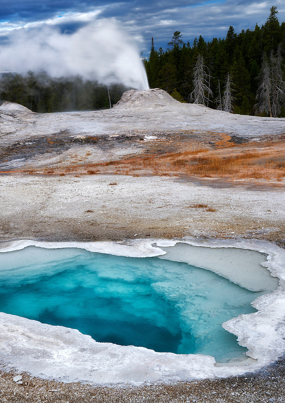Heart Spring with Lion Gyser eruping. Yellowstone National Park, Wyoming