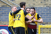 John-Joe O'Toole of Northampton Town (right) celebrates scoring his team's second goal to make it 2-2 during the Sky Bet League 2 match between Stevenage and Northampton Town at the Lamex Stadium, Stevenage, England on 19 March 2016. Photo by David Horn / PRiME Media Images.