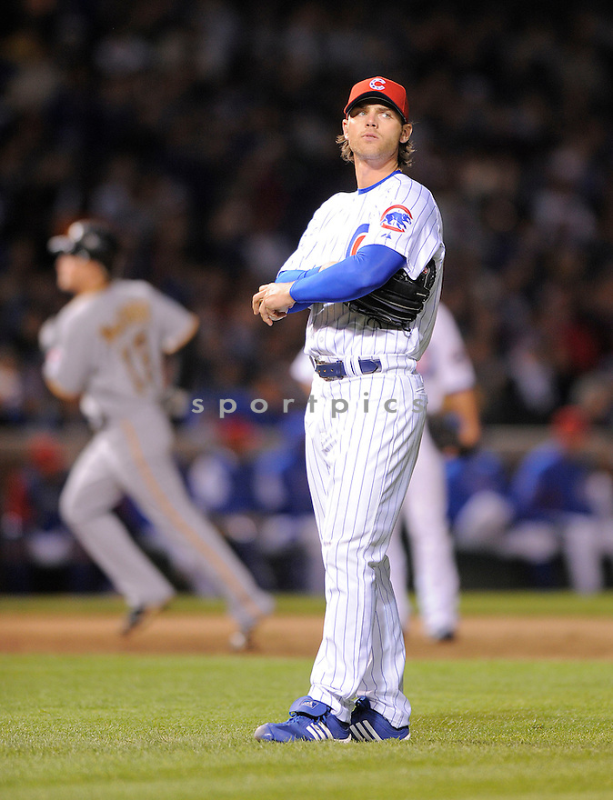 NEAL COTTS, of the Chicago Cubs , in action during the Cubs game against the Pittsburgh Pirates on May 25, 2009 in Chicago, IL. The Pirates beat the Cubs 10-8.