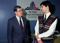 Jean Allaire (L), leader<br /> Mario Dumont (R)	<br /> Action démocratique du Québec (ADQ)<br /> in March 1994<br /> <br /> This party was founded in 1994 by Québec LIBERAL PARTY dissidents. After the rejection of the CHARLOTTETOWN ACCORD in October 1992, Mario Dumont, leader of the Young Liberals of Québec, and Jean Allaire a member of the executive committee of the Québec Liberal Party, left the Liberal Party when its members decided not to defend their platform proposition of 22 fields of exclusive jurisdiction claimed on behalf of Québec.<br /> <br /> The dissidents formed an initial amalgamation, le groupe de Réflexion Québec, followed in December 1993 by Action Québec. The (ADQ) party was founded only the following year, placing Mario Dumont, 23, the youngest party leader in Québec, at its head. The ADQ presented its first electoral platform on 5 and 6 March 1994, when 612 delegates from all the Québec regions adopted a Plan national de redressement (National recovery plan), bearing some twenty propositions aimed at elaborating an economic strategy and stabilizing government finances.<br /> <br /> In the September 1994 elections, the ADQ elected only a single candidate, Mario Dumont, in Rivière-du-Loup, but still obtained nearly 10 percent support of Quebec voters, even if it did not present candidates in all the electoral districts.<br /> <br /> In June 1995, Mario Dumont, Lucien BOUCHARD, then leader of the BLOC QUÈBÈCOIS, and Jacques PARIZEAU, leader of the PARTI QUÈBECOIS, signed an agreement that united these three parties within the Yes camp and partnered them for the formulation of the referendum question (see QUÈBEC REFERENDUM 1995).<br /> <br /> In the 30 November 1998 elections, only Mario Dumont was elected, again in Rivière-du-Loup, if the ADQ increased its percentage of support, by about 500 000 votes. The ADQ did not succeed in passing the critical voting threshold of 15 percent, making it a third party. However, the ADQ fought for proportional representation in the NATIONAL ASSEMBLY. Bringing together man