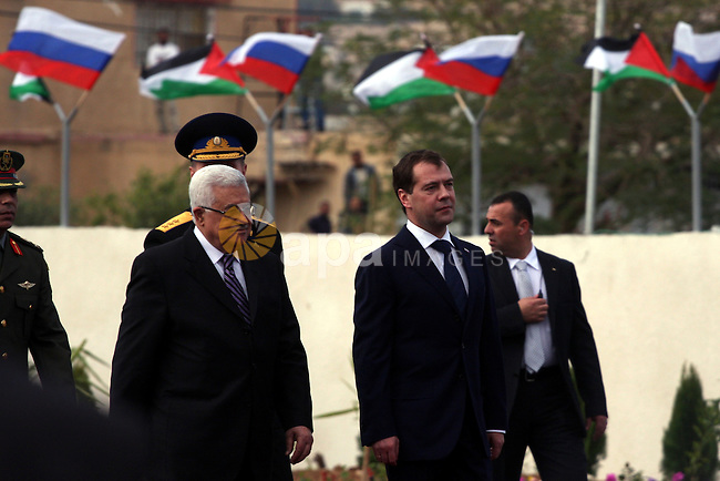 Palestinian President Mahmoud Abbas and Russian President Dmitry Medvedev review an honor guard prior to their meeting in the West Bank town of Jericho, Tuesday, Jan. 18, 2011. Medvedev arrived in the West Bank on Tuesday for a visit seized by the Palestinians as an opportunity to showcase their progress toward building an independent state. Photo by Issam Rimawi