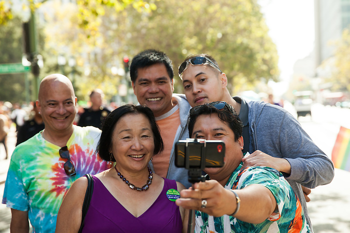 Oakland Mayor Jean Quan poses for a photo with participants at the 2014 Oakland Pride Parade.