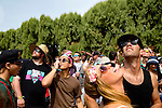 Music fans watch a drone pass overhead as they wait for the gates to open at Weekend 1 of the Coachella Valley Music and Arts Festival in Indio, California April 10, 2015. (Photo by Kendrick Brinson)
