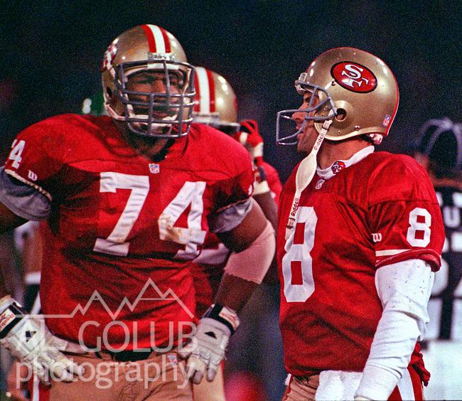 San Francisco 49ers vs. Philadelphia Eagles at Candlestick Park Monday, January 3, 1994.  Eagles Beat 49ers 37-34-OT.  San Francisco 49ers guard Steve Wallace (74) and quarterback Steve Young (8).