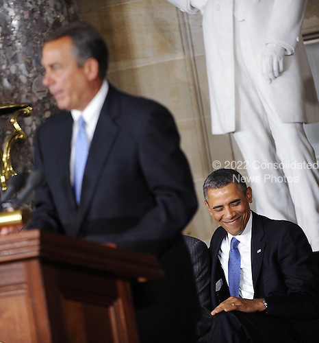 Speaker of the House John Boehner speaks as President Barack Obama gestures during the unveiling of a statue of Rosa Parks at the United States Capitol February 27, 2013 in Washington, DC. Photo by Olivier Douliery/ABACAUSA.com.Credit: Olivier Douliery / Pool via CNP