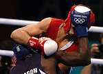 US Boxer Vanes Martirosyan get a face full of glove from Lorenzo Aragon Armenteros during his 69kg Welterweight loss at Peristeri Olympic Boxing Hall during the 2004 Summer Olympic Games in Athens,Greece on Thursday, August 19th, 2004..         DENVER POST PHOTO BY STEVE DYKES