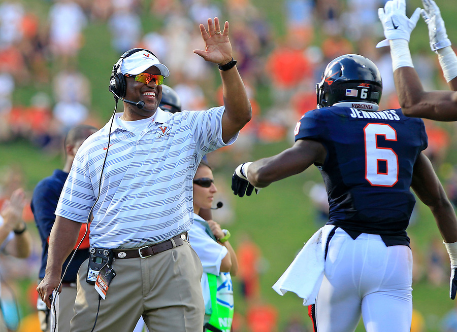 Virginia head coach Mike London reacts alongside Virginia wide receiver Darius Jennings (6) after a 3rd quarter touchdown during the game Saturday Sept. 6, 2014 at Scott Stadium in Charlottesville, VA. Virginia defeated Richmond 45-13. Photo/Andrew Shurtleff