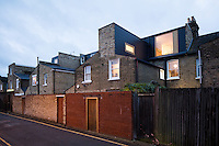 The Victorian home has been given a modernist aesthetic. A mansard loft extension has created additional space.