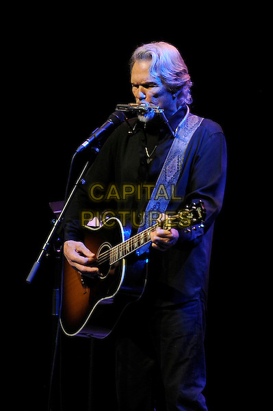 Kris Kristofferson.Performing in concert, Royal Festival Hall, London, England, UK, .7th December 2012..half length playing guitar playing microphone half length live on stage music gig harmonica .CAP/MAR.© Martin Harris/Capital Pictures.