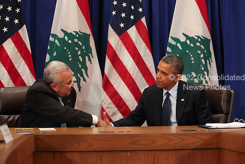 United States President Barack Obama, right, shakes hands with President Michel Suleiman of Lebanon, left, after addressing the 68th United Nations General Assembly in New York, New York on Tuesday, September 24, 2013.<br /> Credit: Allan Tannenbaum / Pool via CNP