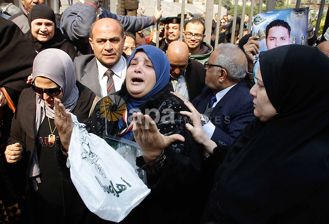 Egyptian family members of victims of the Port Said massacre react outside the Court of Cassation following the court's ruling in the case, in Cairo, on February 20, 2017. An Egyptian court upheld death sentences against 10 people convicted over rioting that claimed 74 lives at a stadium in Port Said in 2012, judicial and security officials said. The riot, the country's deadliest sports-related violence, broke out when fans of home team Al-Masry and Cairo's Al-Ahly clashed after a premier league match between the two clubs. Photo by Stranger