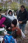 Volunteer Monique Fritsche (centre) serving food as part of the We Picknick group which distributes food to newly-arrived refugees in Berlin. The volunteer initiative was one of many initiated by citizens of the city to help refugees. Around 60,000 refugees arrived in the city in the first 10 months of 2015, out of an overall total of around 850,000 in the whole of Germany.