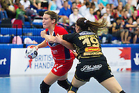30 MAY 2012 - LONDON, GBR - Ewa Palies (GBR) of Great Britain (left, in red and blue) finds her path to goal blocked by Sara Vukcevic (MNE) of Montenegro (right, in black and gold) during the women's 2012 European Handball Championship qualification match at the National Sports Centre in Crystal Palace, Great Britain .(PHOTO (C) 2012 NIGEL FARROW)