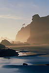 Olympic National Park, Shi Shi Beach, Point of the Arches, Washington State, Pacific Northwest, man hiking on the beach, sea stacks, sunset,  Pacific Ocean, Northwest coast, Olympic Peninsula, North America, USA,.