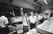 """Three of the four Apollo 13 Flight Directors applaud the successful splashdown of the Command Module """"Odyssey"""" while Dr. Robert R. Gilruth, Director, Manned Spacecraft Center (MSC), and Dr. Christopher C. Kraft Jr., MSC Deputy Director, light up cigars (upper left) in Houston, Texas on April 17, 1970. The Flight Directors are from left to right: Gerald D. Griffin, Eugene F. Kranz and Glynn S. Lunney. Apollo 13 crew members, astronauts James A. Lovell Jr., Commander; John L. Swigert Jr., Command Module pilot, and Fred W. Haise Jr., Lunar Module pilot, splashed down at 12:07:44 (CST) in the South Pacific Ocean, approximately four miles from the Apollo 13 prime recovery ship, the U.S.S. Iwo Jima..Credit: NASA via CNP"""