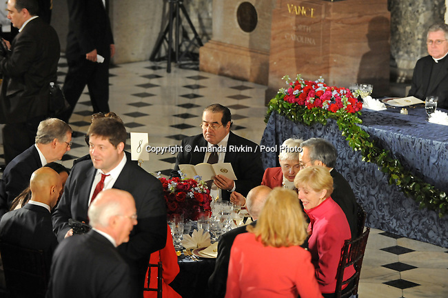 Supreme Court Justice Anthony Scalia looks over the menu at the luncheon following Barack Obama's swearing in as the 44th President of the United States at Statuary Hall in the U.S. Capitol in Washington, DC on January 20, 2009.