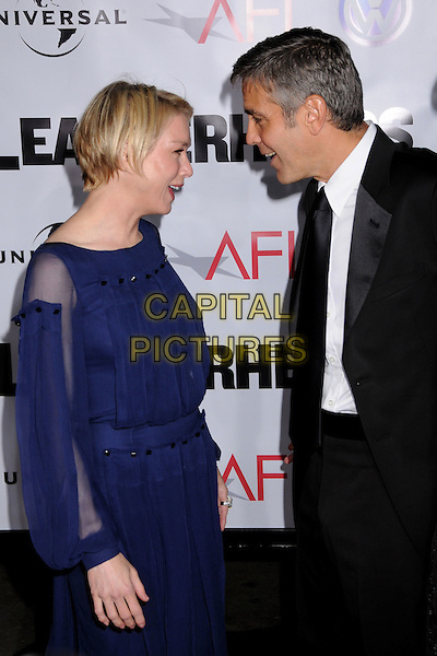 "RENEE ZELLWEGER & GEORGE CLOONEY.""Leatherheads"" Los Angeles Premiere at Grauman's Chinese Theatre, Hollywood, California, USA..March 31st, 2008.half length purple sheer dress black suit profile funny .CAP/ADM/BP.©Byron Purvis/AdMedia/Capital Pictures."