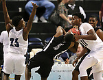 Desert Pines defender Darius Mitchell, right, gets called for a foul in a play with Cheyenne's Kavon Williams during the NIAA 3A state basketball championship game in Reno, Nev., on Saturday, Feb. 24, 2018. Desert Pines won 48-44 in overtime. Cathleen Allison/Las Vegas Review-Journal
