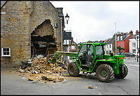 BNPS.co.uk (01202 558833)<br /> Pic: GrahamHunt/BNPS<br /> <br /> Epic Fail...<br /> <br /> Inept ram raiders have demolished half the wall of a furniture showroom in the sleepy Dorset town of Beaminster last night.<br /> <br /> The cash machine is still to believed to be in the rubble and the robbers were forced to abandon the tractor used in the raid.