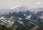 Approching the West Buttress (center left) and South Buttress of Mt. McKinley (20,300 ft).  Taken from right seat of a DeHaveland Beaver Aircraft, the Bush Pilot's Work Horse at the service ceiling of the Beaver  (~ 11,000 ft,).