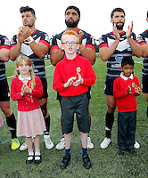 London Broncos with mascots during the Kingstone Press Championship game between London Broncos and Oldham Roughyeds at Ealing Trailfinders, Ealing, on Sun June 19, 2016