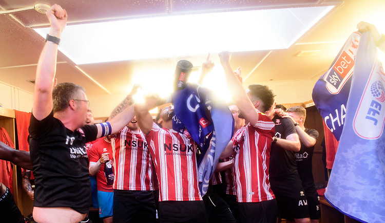 Lincoln City players and coaching staff celebrate in the changing room after winning the league<br /> <br /> Photographer Chris Vaughan/CameraSport<br /> <br /> The EFL Sky Bet League Two - Lincoln City v Tranmere Rovers - Monday 22nd April 2019 - Sincil Bank - Lincoln<br /> <br /> World Copyright © 2019 CameraSport. All rights reserved. 43 Linden Ave. Countesthorpe. Leicester. England. LE8 5PG - Tel: +44 (0) 116 277 4147 - admin@camerasport.com - www.camerasport.com