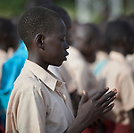 Students pray at the beginning of the school day at the Loreto Primary School outside Rumbek, South Sudan. The school is run by the Institute for the Blessed Virgin Mary--the Loreto Sisters--of Ireland.