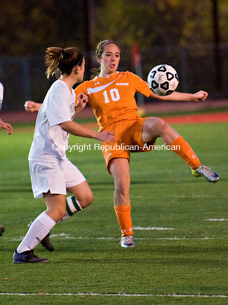 WOLCOTT, CT-27 October 2014-102714EC01--   Watertown's Rebecca Lopes tries to control the ball Monday night in Wolcott against Holy Cross'  Caitlin Villano. The Crusaders lost to the Indians, 2-0. Erin Covey Republican-American