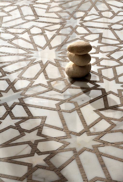 Castilla, a waterjet and hand-cut stone mosaic shown in honed Jura Grey and polished Calacatta Tia, is part of the Miraflores collection by Paul Schatz for New Ravenna.