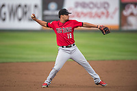 Billings Mustangs third baseman Juan Martinez (18) throws to first base during a Pioneer League game against the Idaho Falls Chukars at Melaleuca Field on August 22, 2018 in Idaho Falls, Idaho. The Idaho Falls Chukars defeated the Billings Mustangs by a score of 5-3. (Zachary Lucy/Four Seam Images)