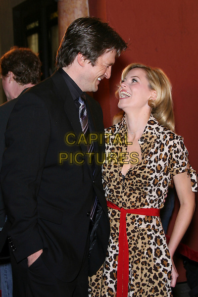 "NATHAN FILLION & ELIZABETH BANKS. ""Slither"" Premiere - Arrivals held at Vista Theatre, Los Feliz, California, USA.  .March 9th, 2006.Photo: Zach Lipp/AdMedia/Capital Pictures.Ref: ZL/ADM.half length black leopard print dress suit jacket.www.capitalpictures.com.sales@capitalpictures.com.© Capital Pictures."