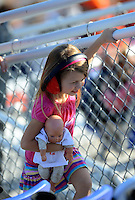 Apr. 13, 2012; Concord, NC, USA: A young female NHRA fan in the grandstands during qualifying for the Four Wide Nationals at zMax Dragway. Mandatory Credit: Mark J. Rebilas-