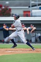 Kurt Hoekstra (25) of the Danville Braves follows through on his swing against the Burlington Royals at Burlington Athletic Park on July 12, 2015 in Burlington, North Carolina.  The Royals defeated the Braves 9-3. (Brian Westerholt/Four Seam Images)