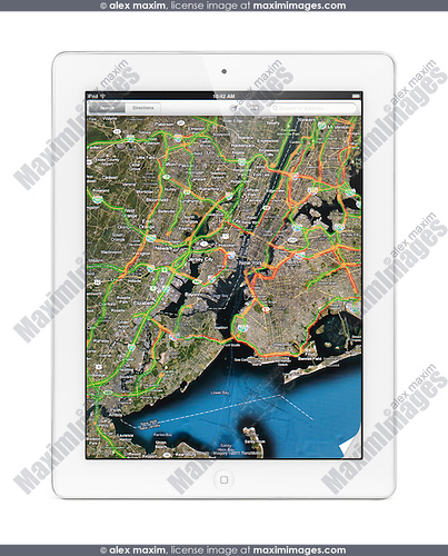 Apple iPad 2 tablet computer displaying a map of New York with traffic by Google Maps on its screen. Isolated with clipping path on white background.