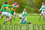 David O'Connor of Ballydonoghue releases the ball before the tackle of Knocknagoshel's Michael Keane and Lee Roche(6) in the County League Division 5 last Sunday in Knocknagoshel.