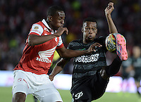 BOGOTÁ -COLOMBIA, 16-11-2014. Yerry Mina (Izq) de Independiente Santa Fe disputa el balón con Jonathan Copete (Der) jugador de Atlético Nacional durante partido por la fecha 1 de los cuadrangulares finales de la Liga Postobón II 2014 jugado en el estadio Nemesio Camacho el Campín de la ciudad de Bogotá./ Yerry Mina player (L) of Independiente Santa Fe fights for the ball with Jonathan Copete (R) player of Atletico Nacional during the match for the first date of the final quadrangular of the Postobon League I 2014 played at Nemesio Camacho El Campin stadium in Bogotá city. Photo: VizzorImage/ Gabriel Aponte / Staff