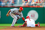 3 July 2009: Washington Nationals' center fielder Nyjer Morgan recently acquired from the Pittsburgh Pirates, steals second base ahead of the throw to Yunel Escobar during a game against the Atlanta Braves at Nationals Park in Washington, DC. The Braves defeated the Nationals 9-8, to take the first game of the 3-game weekend series. Mandatory Credit: Ed Wolfstein Photo
