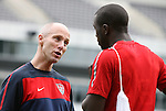 28 May 2010: Head coach Bob Bradley (left) talks to Jozy Altidore (right). The United States Men's National Team held a practice session at Lincoln Financial Field in Philadelphia, Pennsylvania the day before playing Turkey in their final home friendly prior to the 2010 FIFA World Cup in South Africa.