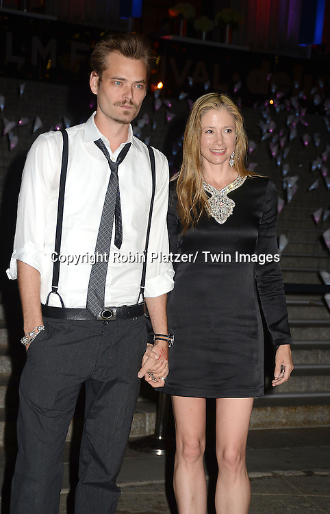 Mira Sorvino in black Bird dress and husband Chris Backus attends the Vanity Fair Party for the 2013 Tribeca Film Festival on April 16, 2013 at State Suprme Courthouse in New York City.
