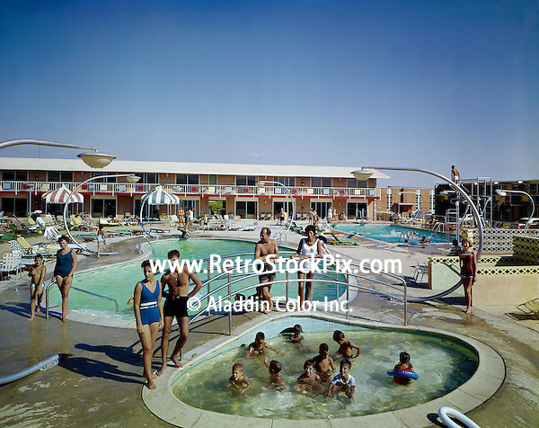Kids playing in the Country Squire Motel kiddie pool while their parents watch. 1960's