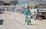 Children play in the street in a camp for internally displaced families in Ankawa, near Erbil, Iraq, on April 8, 2016. Residents of the camp, mostly Christians, were displaced from Mosul, Qaraqosh and other communities in Iraq when ISIS swept through the area in 2014.