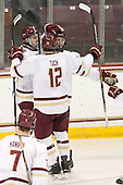 Zach Sanford (BC - 24), Alex Tuch (BC - 12) and Adam Gilmour (BC - 14) celebrate Gilmour's goal. - The Boston College Eagles defeated the visiting Merrimack College Warriors 2-1 on Wednesday, January 21, 2015, at Kelley Rink in Conte Forum in Chestnut Hill, Massachusetts.