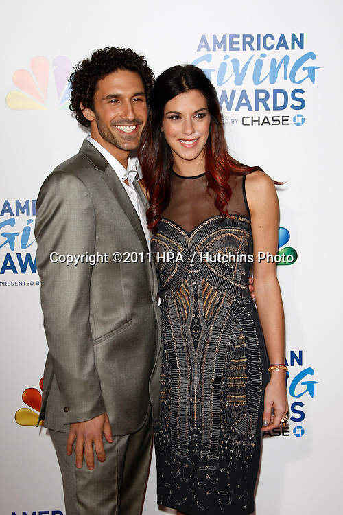 LOS ANGELES - DEC 9:  Ethan Zohn; Jenna Morasca arrives at the 2011 American Giving Awards at Dorothy Chandler Pavilion on December 9, 2011 in Los Angeles, CA