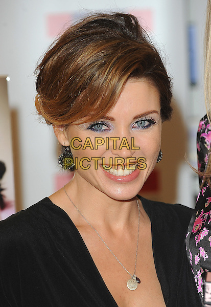 DANNII MINOGUE .launches her new fragrance Project D by Dannii and Tabitha at The Perfume Shop, Oxford Street, London, England, UK, 18th November 2010..portrait headshot black smiling  necklace silver earrings .CAP/BEL.©Tom Belcher/Capital Pictures.