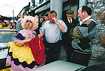 A participant in the Fleadh Nua parade attempts to sell her drawers to amused bystanders - June 4, 1999. Photograph by John Kelly