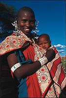 Noorkishon, a Maasai woman with her baby, Maria. Oltepessi Maasai Village, Tanzania.